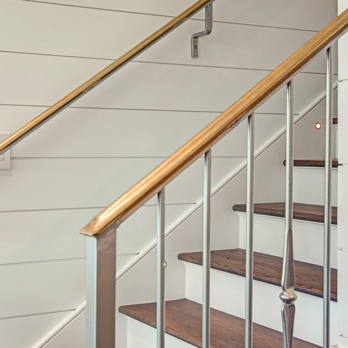 Fancy staircase with panel wall